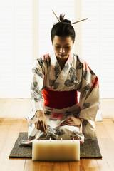 Woman wearing kimono lighting candles