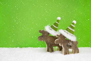 Dekoration Weihnachten in grün und weiß mit Elch auf Hintergrund