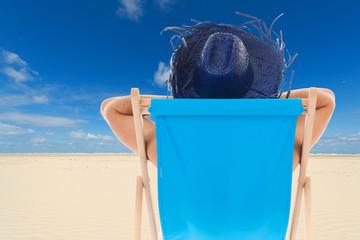 man in chair at the beach