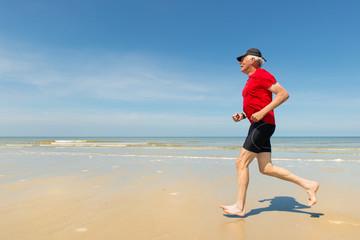 Senior runner at the beach