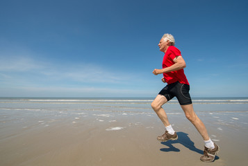 Senior runner at the beach