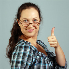 smiling woman shows okay