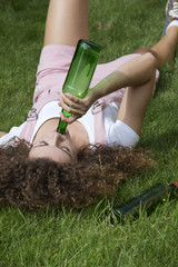 Teenage drinking problem Girl with beer bottle