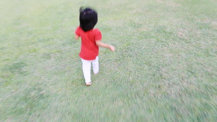 Baby running in grass field