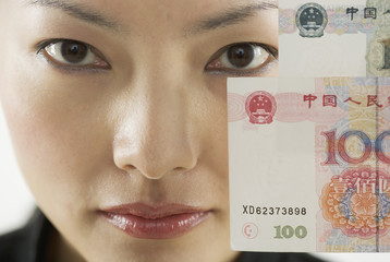 Close up portrait of woman holding foreign currency