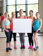 - group of women witn white blank billboard