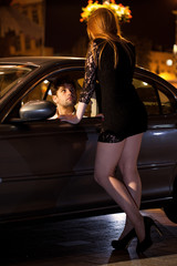 Man chatting up prostitute
