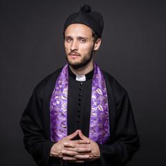 Studio portrait: serious pastor