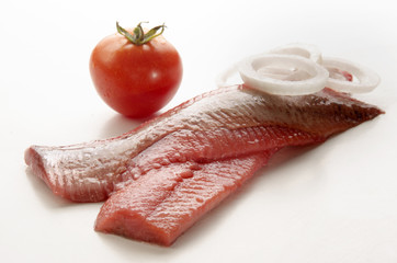 pink herring with onion and tomato
