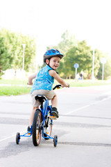 Baby boy on bike with crash helmet