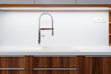 A closeup of a sink with tap in contemporary kitchen