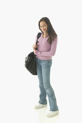 Portrait of teenage girl with book bag