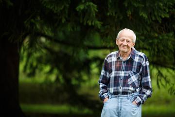 Laughing 80 year old senior elder man outside