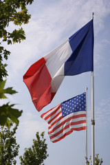 American and French waving flag at an memorial site in Caretan