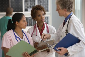 Doctors and nurse talking