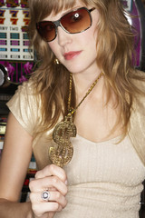 Young woman wearing a pendant and sunglasses