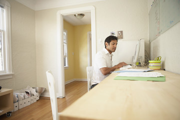 Young businessman using a computer