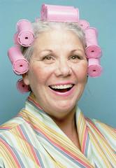 Senior woman wearing hair rollers