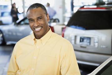Car salesman smiling
