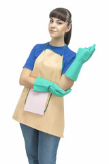 Cleaning Concept: Young Optimistic Housewife with Protective Rub