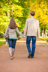 Couple walking together in park on a fall day