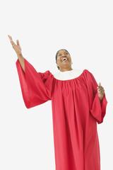 Studio shot of senior African woman wearing a choir robe and singing