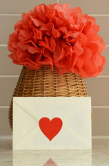 Woven red paper flower basket and a love letter