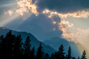 sun rays over the rockies