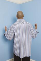 Rear view of African American man facing corner