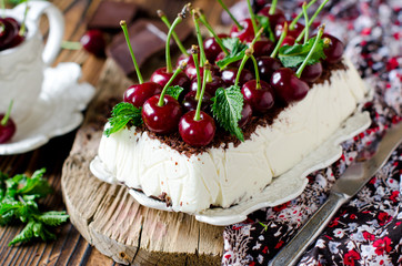 Cheesecake with chocolate and cherries. selective Focus
