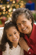 Hispanic grandmother and granddaughter smiling