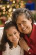 Hispanic grandmother and granddaughter smiling