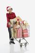 Senior Hispanic woman with shopping cart full of gifts