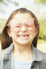 Hispanic girl wearing big glasses
