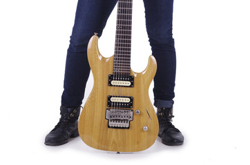 Electric guitar in between girl's legs