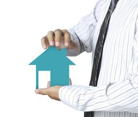 man holding house