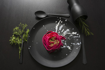 pink spaghetti, black place setting