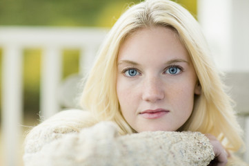 Close up of young woman wearing sweater