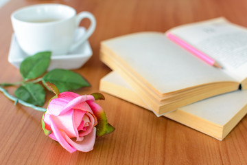 pink rose with book and coffee