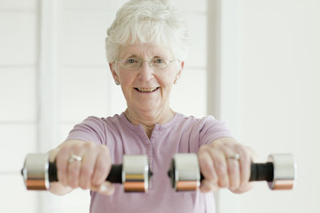 Senior woman lifting free weights