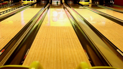 Ball rolling pushed from kids bowling ramp