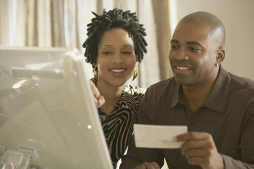 African couple using computer