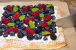 Homemade berry tart with knife
