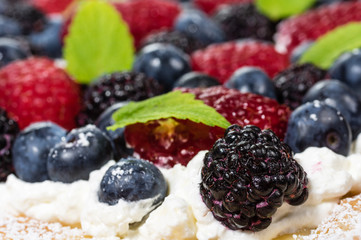 Closeup of fresh berry tart with cream