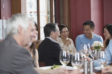 Senior Asian couple and young Asian couple at restaurant