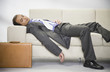 Indian businessman sleeping on sofa