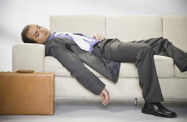 Indian businessman sleeping on sofa