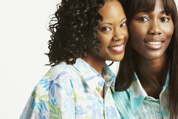 Studio shot of two African women smiling