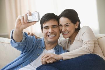Hispanic couple taking own photograph