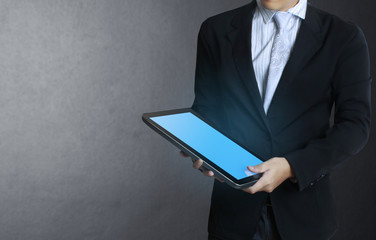 tablet computer isolated in a hand